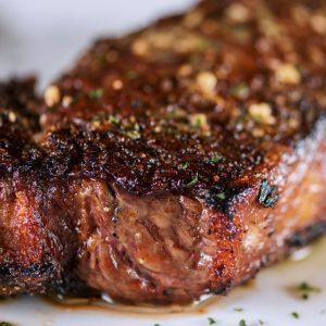 barbecued new york strip steak with seasoning
