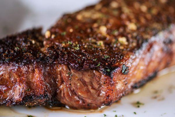 barbecued new york strip steak with seasoning