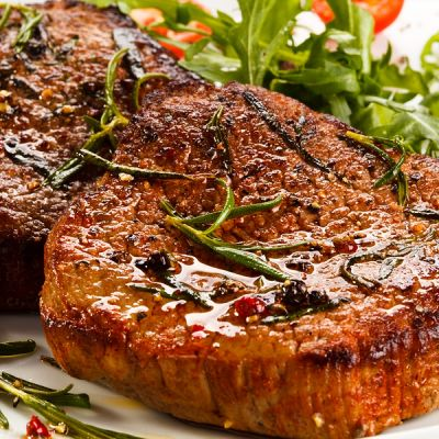 grilled round eye steak with seasoning and vegetables
