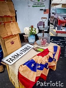 Hipwell ranch display at a farmers market with a table and a farm to table sign